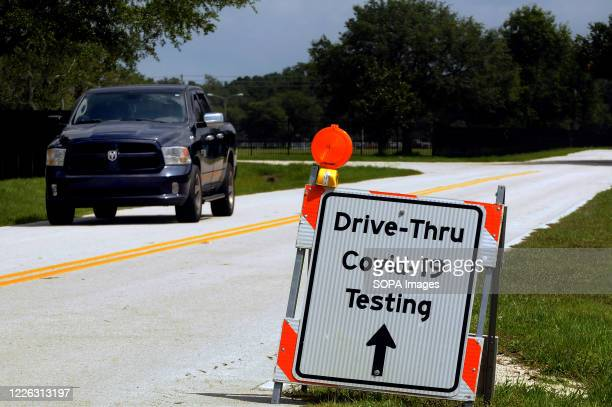 Sign directs people to a drive through COVID-19 testing site operated by the Florida Department of Health at Osceola Heritage Park. Coronavirus cases...
