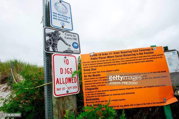 A sign directs people to beach rules during the pandemic to help stop the spread of Covid19 at Wingaersheek Beach in Gloucester Massachusetts on...