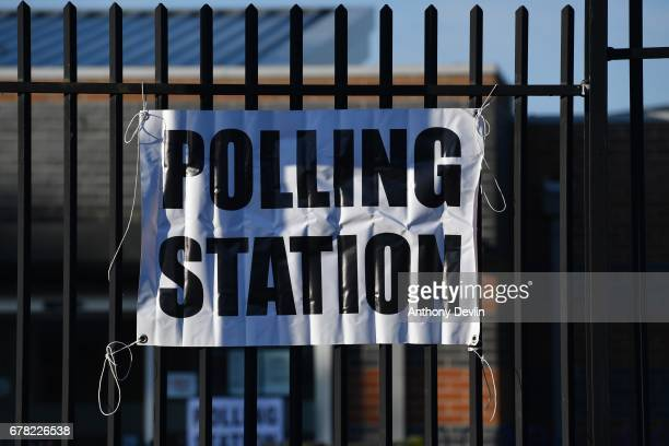 A sign directs to a polling station in Goldborne on May 4 2017 in greater Manchester England Six new metro Mayors will be elected today in areas...