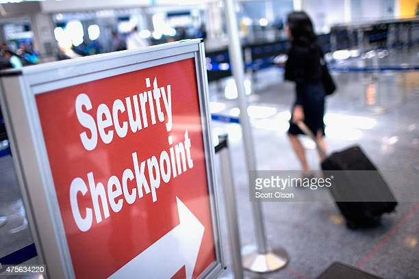 A sign directs travelers to a security checkpoint staffed by Transportation Security Administration workers at O'Hare Airport on June 2 2015 in...