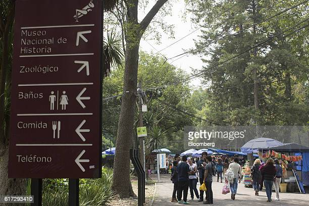 A sign directs visitors inside the first section of Chapultepec Park in Mexico City Mexico on Saturday Sept 24 2016 Chapultepec also known as the...