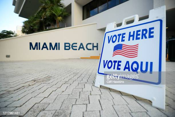 Sign directs voters to a polling location during the Florida presidential primary on March 17, 2020 at Miami Beach City Hall in Miami Beach, Florida....