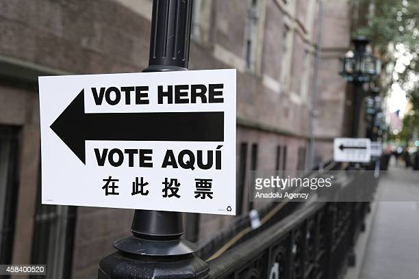 A sign directs voters to a polling place is seen during the US midterm elections in New York United States on November 4 2014 US voters were headed...