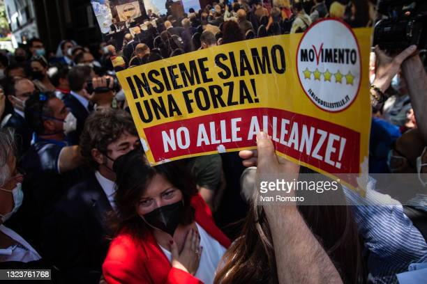 Sign displayed by an activist of the 5 Star Movement against the alliance with the Democratic Party on June 15, 2021 in Naples, Italy. The political...