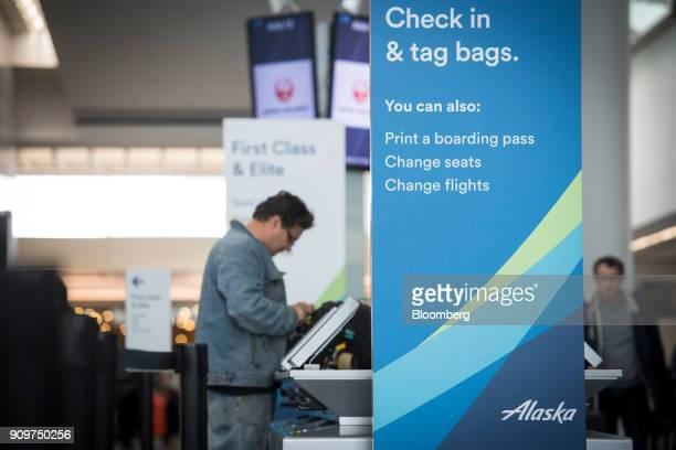 A sign displaying Alaska Air Group Inc self checkin information is seen at the San Francisco International Airport in San Francisco California US on...
