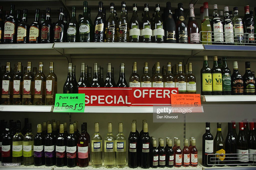 A sign displaying special offers on alcohol hangs on the shelves of an Off Licence named 'Little Store Cheap Booze', in Thornton Heath on February 21, 2011 in London, England. Doctors have warned that inadequate regulations on alcohol may cost the lives of around 250,000 people in England and Wales over the next 20 years. A minimum price of 50p per unit is urgently needed, according to leading liver disease specialists.