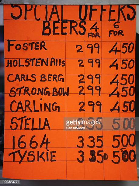 A sign displaying special offers on alcohol hangs on the shelves of an Off Licence named 'Little Store Cheap Booze' in Thornton Heath on February 21...