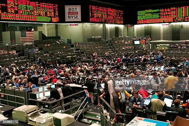 A sign displaying the new ticker symbol BOT hangs over the trading floor at the Chicago Board of Trade October 19 2005 in Chicago Illinois The CBOT...