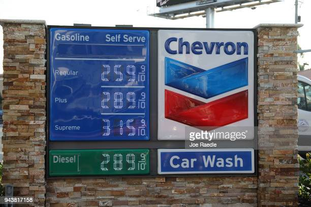 A sign displaying the price of gasoline per gallon is seen at a Chevron gas station as reports indicate that the price of gas continues to rise on...