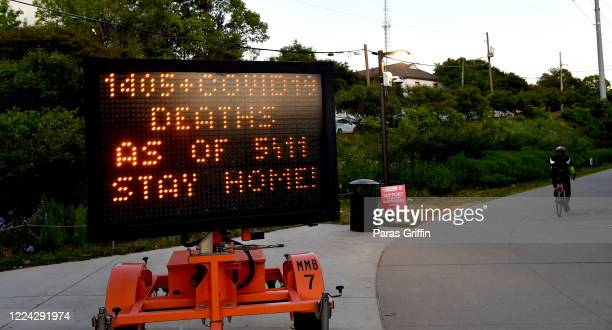 A sign displays 1405 Covid19 Deaths As 5/11 Stay Home at the Atlanta Beltline near Piedmont Park as the coronavirus pandemic continues on May 11 2020...