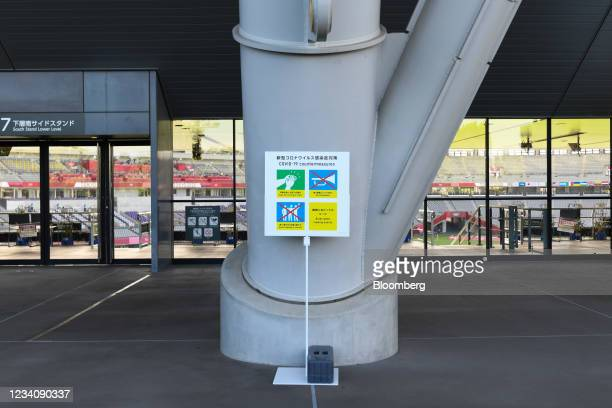 Sign displays coronavirus prevention measures outside Ajinomoto Stadium ahead of an opening round women's football match between the U.S. And Sweden...