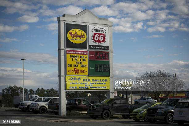 Sign displays fuel prices at a Phillips 66 gas station in Shelby, North Carolina, U.S., on Wednesday, Jan. 24, 2018. Phillips 66 is scheduled to...