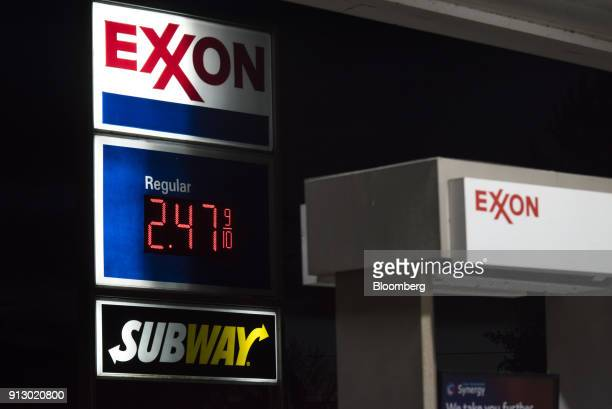 A sign displays fuel prices at an Exxon Mobil Corp gas station in Nashport Ohio US on Friday Jan 26 2018 Exxon Mobil Corp is scheduled to release...