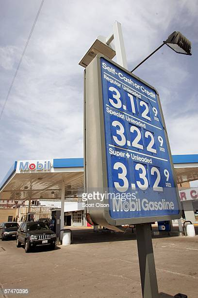 A sign displays gas prices at a Mobil gas station April 27 2006 in Chicago Illinois Exxon Mobil Corp the parent company of Mobil and the world's...