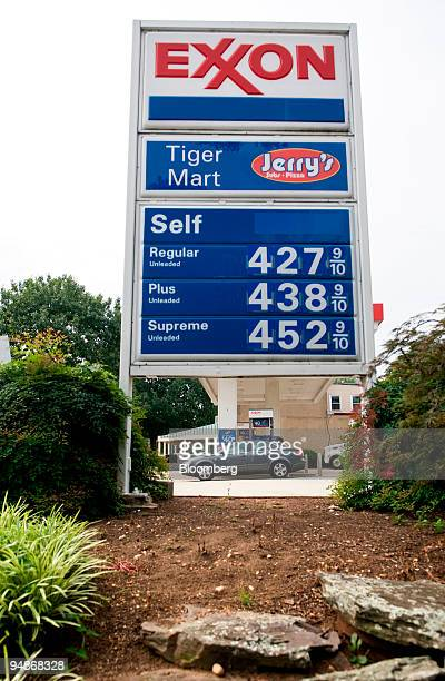 A sign displays gas prices at an Exxon Mobil station in Washington DC US on Thursday July 31 2008 Exxon Mobil Corp the world's biggest oil company...