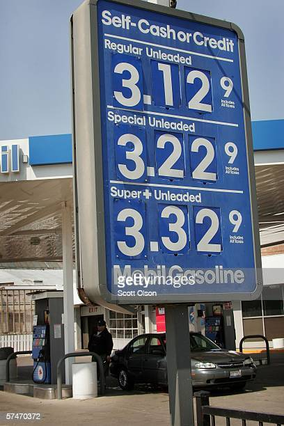 A sign displays gasoline prices at a Mobil gas station April 27 2006 in Chicago Illinois Exxon Mobil Corp the parent company of Mobil and the world's...