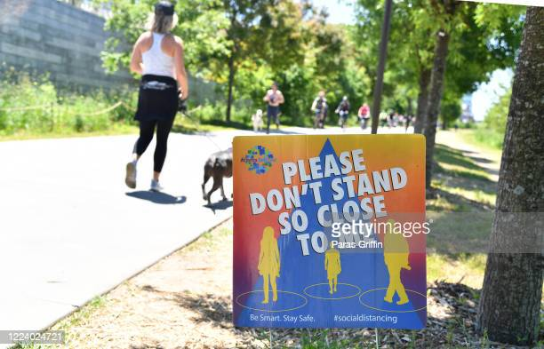 A sign displays Please Don't Stand So Close To Me at the Atlanta Beltline as the coronavirus pandemic continues on May 10 2020 in Atlanta Georgia...