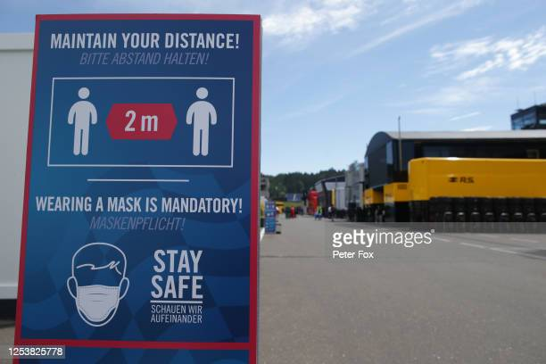 A sign displays social distancing measures during previews for the F1 Grand Prix of Austria at Red Bull Ring on July 02 2020 in Spielberg Austria