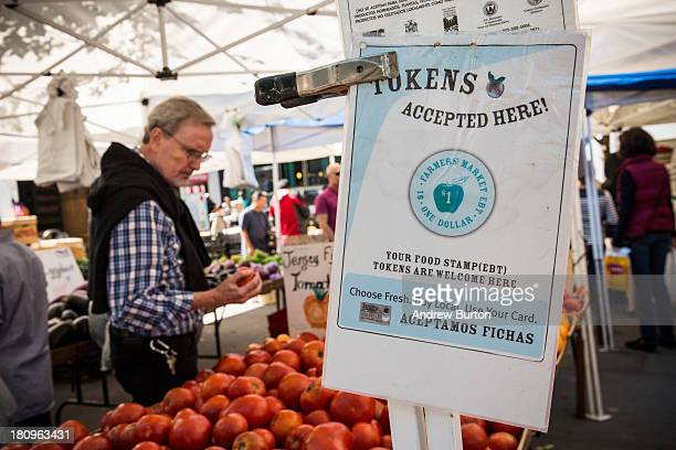 A sign displays that a shop accepts Electronic Benefits Transfer more commonly known as Food Stamps in the GrowNYC Greenmarket in Union Square on...