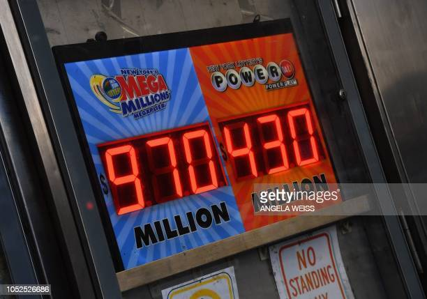 A sign displays the Mega Millions and Power Ball jackpots on October 19 2018 in New York City The Mega Millions jackpot is currently up to $970...