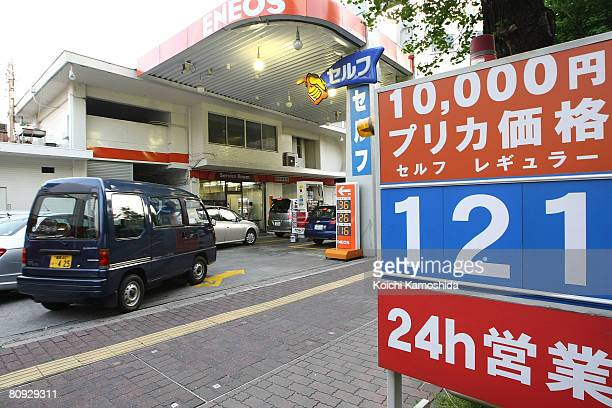 A sign displays the price of gasoline per litter at a gas station on April 30 2008 in Tokyo Japan Japanese Prime Minister Yasuo Fukuda announced...