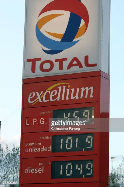 A sign displays the price of petrol at nearly GBP 102 per litre at a Total fuel station forecourt on November 8 2007 in Warrington Cheshire England...