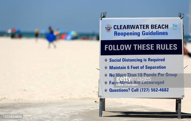 A sign displays the rules as people visit Clearwater Beach after Governor Ron DeSantis opened the beaches at 7am on May 04 2020 in Clearwater Florida...