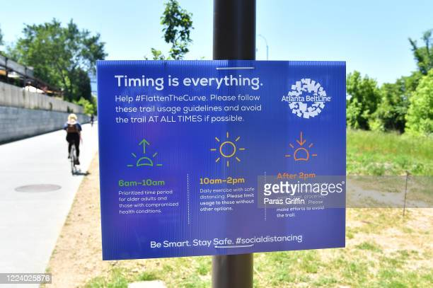 A sign displays Timing is everything Help Flatten The Curve at the Atlanta Beltline as the coronavirus pandemic continues on May 10 2020 in Atlanta...