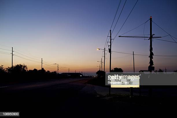 A sign emploring help sits illuminated along a stretch of road leading away from Venice Louisiana ground zero for BP and federal agencies...