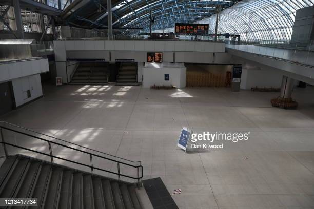 A sign encouraging social distancing is seen at Waterloo station on May 18 2020 in London England The British government has started easing the...