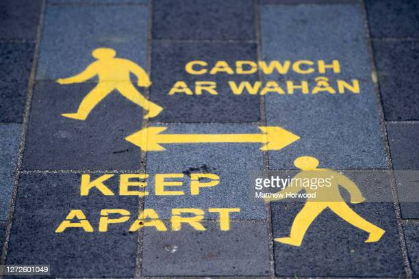 A sign encouraging social distancing painted on the pavement on September 14 2020 in Newport Wales First Minister of Wales Mark Drakeford has...