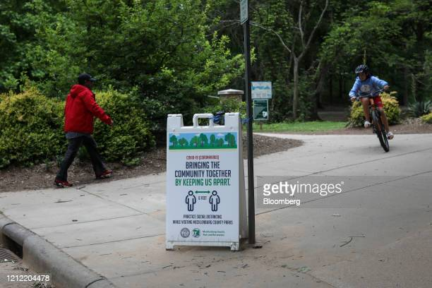 A sign enourages social distancing at Freedom Park in Charlotte North Carolina US on Friday May 8 2020 Governor Roy Cooper is lifting certain...