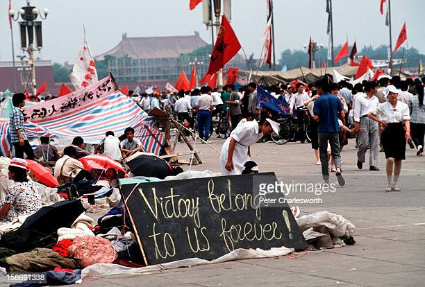 A sign erected by prodemocracy demonstrators proclaims that 'Victory belongs to us forever' in Tiananmen Square Prodemocracy demonstrators filled the...