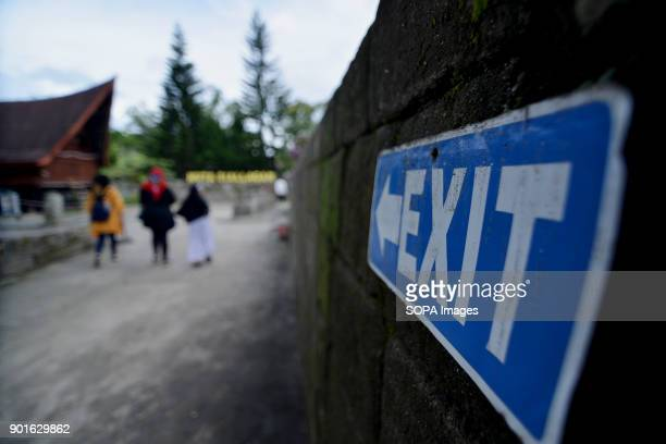 A sign 'exit' seen at the Siallagan location in Samosir The Lake Toba in the north of Sumatra as been formed during the occurrence of a super...
