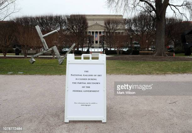 A sign explaining that areas near the National Gallery of Art are closed due to a partial shutdown of the US government is seen on January 7 2019 in...