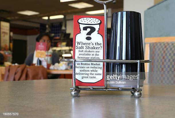 A sign explaining the absence of salt shakers is posted on a table inside a Boston Market restaurant on August 21 2012 in San Francisco California...