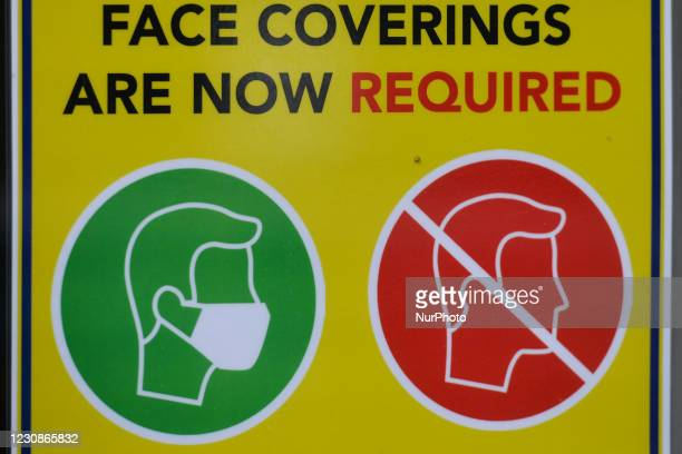 Sign 'Face Coverings Are Now Required' seen in Dublin center during Level 5 Covid-19 lockdown. On Friday, 29 January in Dublin, Ireland.