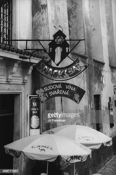 A sign featuring a synagogue and the Star of David on a cafe near the High Synagogue in Prague Czech Republic 1994