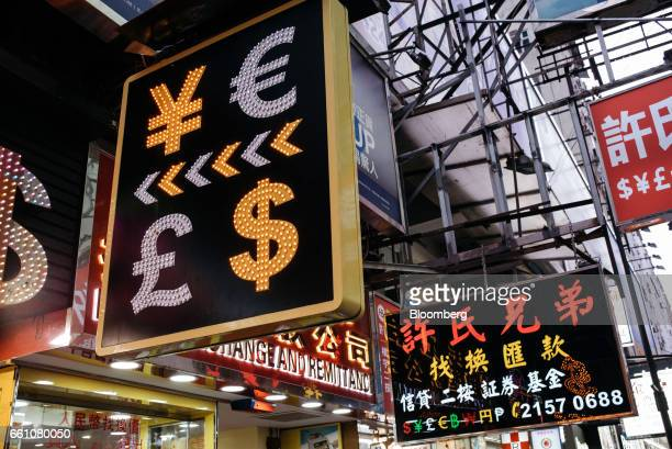 Sign featuring Japanese yen, top left, euro, top right, British pound sterling, bottom left, and U.S. Dollar is displayed at a currency exchange...