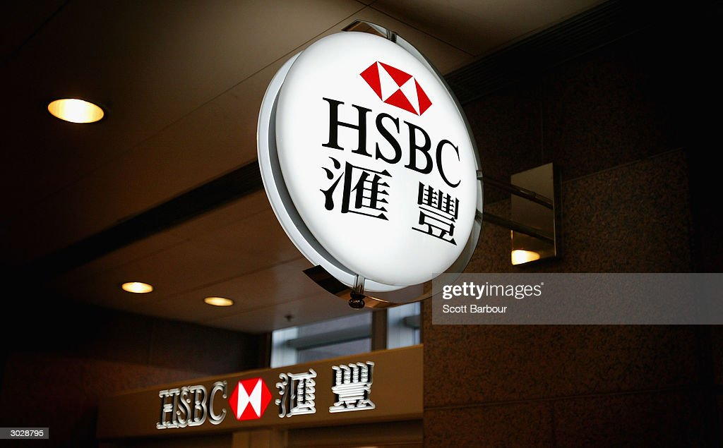 A sign featuring the logo of the banking giant HSBC hangs outside a branch on December 11, 2003 in Hong Kong. The London-based bank, which operates in 79 countries, gave an upbeat tone for the global economy March 1, 2004 including its key Hong Kong market by reporting a record annual pre-tax profit of ?7.7bn ($14.4).