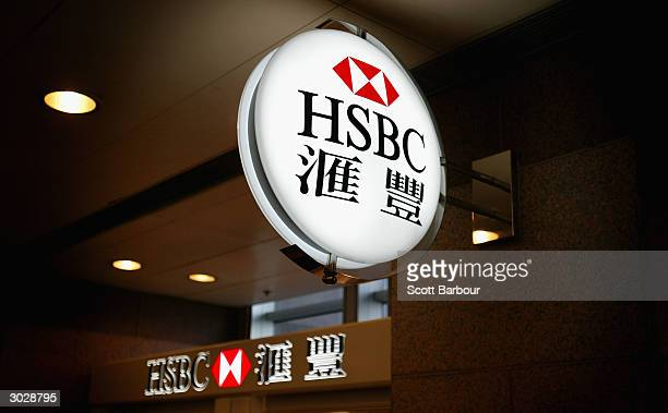 Sign featuring the logo of the banking giant HSBC hangs outside a branch on December 11, 2003 in Hong Kong. The London-based bank, which operates in...