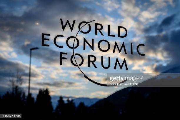 A sign fo the World Economic Forum is seen at sunset in the Congress center ahead of the annual meeting of the World Economic Forum in Davos on...