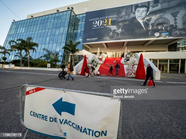 Sign for a coronavirus disease vaccination center installed in front of the red carpet of the Palace on January 13, 2021 in Cannes, France. The...