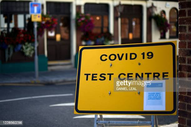 A sign for a Covid19 test centre is pictured in the street in Leyton in east London on September 17 2020 British Prime Minister Boris Johnson said...