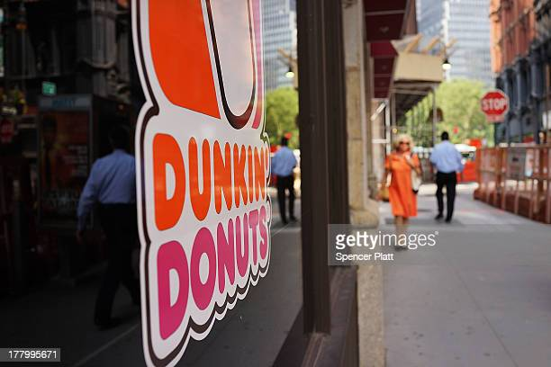 A sign for a Dunkin' Donuts store is viewed on August 26 2013 in New York City Due to minimum wage and overtime violations the US Labor Department...