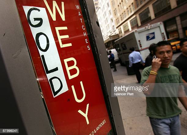 A sign for a jewelry store that buys gold is displayed April 21 2006 in New York City The price of gold rose to $63260 a troy ounce Wednesday the...