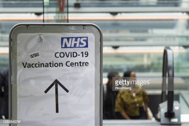 Sign for a mass vaccination event at the London Stadium in London, U.K., on Saturday, June 19, 2021. After inoculating a larger proportion of people...