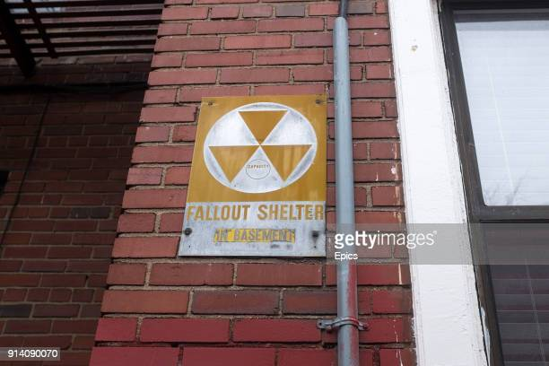 A sign for a nuclear fall out shelter outside a residential block in Brooklyn for a nuclear fall out shelter which is located in the basement