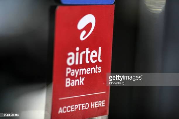A sign for Airtel Payments Bank Ltd operated by Bharti Airtel Ltd is displayed outside a store selling electronics in Bengaluru India on Saturday Feb...