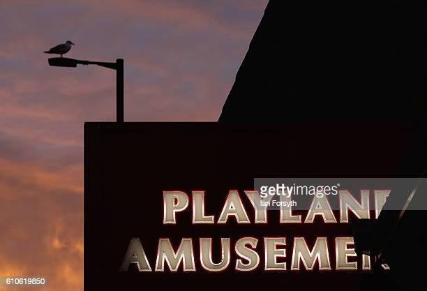 A sign for an amusement arcade on Redcar seafront can be seen at sunrise on September 27 2016 in Redcar United Kingdom One year on since the SSI...
